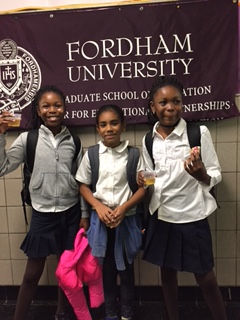 Students with Fordham banner